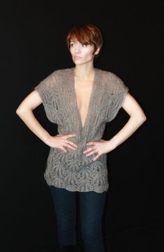 Gorgeous soft and light looking top.  Handknit.