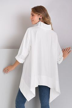 Trapeze Shirt by Planet . This iconic white shirt is a must-have for a creative wardrobe! In breezy poplin, its roomy trapeze shape drapes to long, graceful side points. White Shirt Outfits, White Shirts, Women's Fashion Dresses, Hijab Fashion, Iranian Women Fashion, Mode Hijab, Western Outfits, Contemporary Fashion, Minimal Fashion