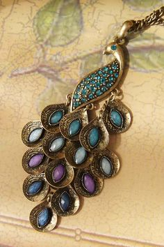 gold peacock with blue and purple toned jewels. i would love this!