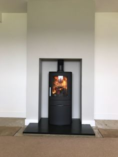 Neo 1 C wood burning stove with riven slate hearth Slate Hearth, Stoves, Wood Burning, Fireplaces, Home Appliances, Living Room, Home Decor, Slate Fireplace, Fireplace Set