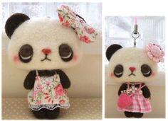 .ooooooh....i'm SO in love with this tiny, little (needle-felted) panda bear!.... she's so kawaii!!...