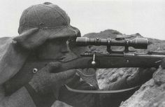 A German sniper with his K98 scope rifle.