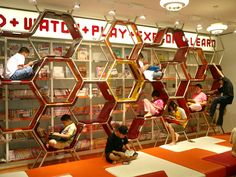 the climbing frame bookshelves in Bankok's TK Park family learning space (note crash mats beneath and shoes off)