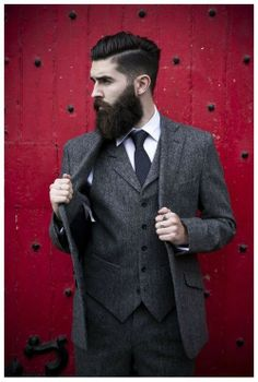 Shop this look for $230: http://lookastic.com/men/looks/blazer-and-vest-and-dress-pants-and-dress-shirt-and-tie/609 — Charcoal Wool Blazer — Charcoal Wool Waistcoat — Charcoal Wool Dress Pants — White Dress Shirt — Black Polka Dot Tie