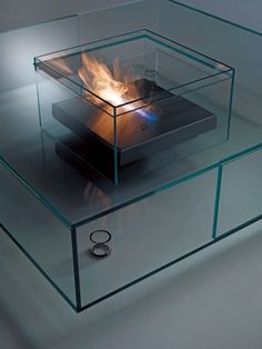 French designer Jean-Marie Massaud has crafted Seasons, an all-glass table that's designed to be used every season. Made in Italy by Glas Italia, the low table features a retaining basin in the center that can be used for various things, like as a vase, a flower box, or an aquarium. You can even get one with a burner that's fueled by bioethanol for a little cozy fire.