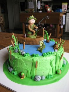 """Fishing Birthday Cake - 9"""" round cake with buttercream icing. Fondant fisherman, boat, and other decorations. Fish is gum paste. Thank you for the inspiration to all of the people who made fishing cakes on here! :) by myra"""