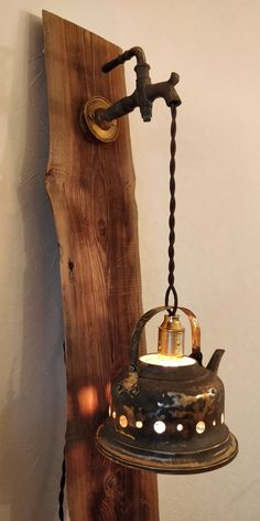 An old teapot, a tap from a barrel, a lid from old stove. Barrel A lamp made of a teapot Rustic Wall Lighting, Rustic Lamps, Wood Lamps, Handmade Home Decor, Diy Home Decor, Wooden Plane, Old Stove, Art Supply Stores, Wooden Diy