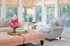 sunroom with bamboo roman shades, coral tufted square, turquoise and gold lamp