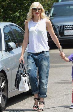 Gwen Stefani.. casual-chic rocker with L.A.M.B. Aarika Satchel..