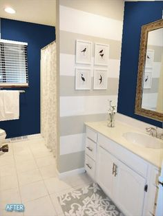 Gorgeous blue with tan & white. Love the striped wall in the bathroom.
