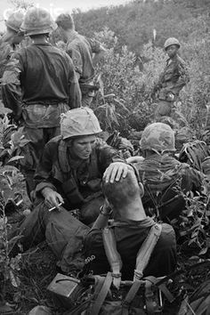 08 Nov 1967, Near Tam Ky, A stressed 1st Cavalry soldier is consoling his buddy moments after an intense firefight on a search and destroy mission 15 miles northwest of Tam Ky. ~ Vietnam War