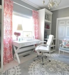 love the rug and curtains but would like curtains to be more of a coral. Desk in front of the window - flooded with natural light.