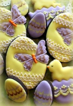 Easter egg cookies embellished with butterflies and cuteness Repinned By:#TheCookieCutterCompany