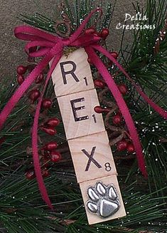 Personalized DOG Scrabble Tile Ornament w/Pewter Paw Print Charm. I could make these for each of my pets with coordinating colored ribbon to match my Christmas decor. #DogChristmas