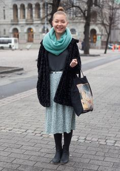 "Paula - Hel Looks - Street Style from Helsinki ""My style is very relaxed. I wear the same clothes at home and in the street. I like neutral and broken colours but prints, too.  I dance flamenco, therefore Spanish flamenco dancers and Madrid street style inspire me."" Street style / blue scarf / gray midi skirt / black boots / black coat"