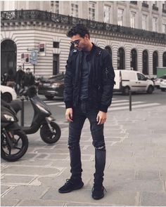 Black washed ripped biker jeans Black washed ripped biker jeans . This Piece features welted zipper near the upper pocket along with a pleated pattern by the knee area. These black washed biker jeans