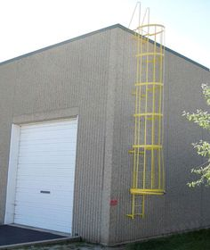 An exterior custom commercial emergency ladder fabrication and installation for an industrial property in the Chicago area.