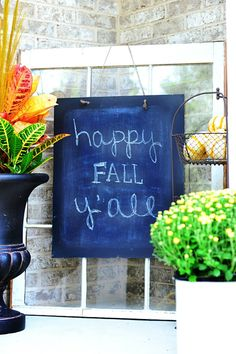 happy fall yall chalkboard sign on window