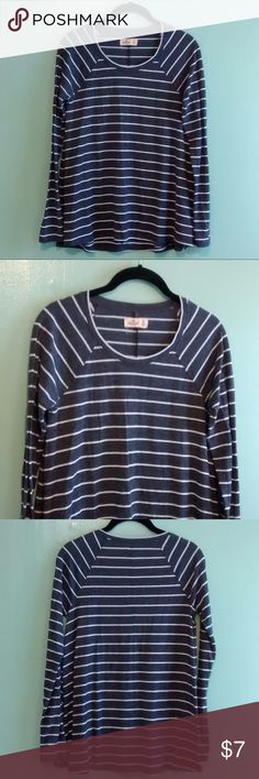 """Grey striped long sleeve tee Soft and like new Hollister size small grey long sleeve shirt with white stripes. Material is 68% polyester, 28% viscose, 4% elastane. Measurements are 25.5"""" from top to bottom, 16"""" bust lying flat and 29"""" opening at bottom hem lying flat. Hollister Tops"""