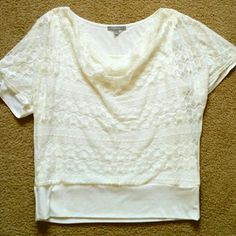 NY Collection Lace Overlay White Dolman Top sz L Beautiful cream/ivory white top. Super soft solid layer with a beautiful lace overlay on the front half. Drapes beautifully, flattering to curves, hides problem tummy areas well! Only had the chance to wear this once. Too big for me now :( Has light marking at back side of one shoulder. I have not attempted to clean it yet. I would guess it comes out easily. Looks like perhaps someone's foundation rubbed off during a hug! Oh, the perils of…