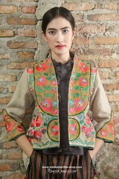 Batik Amarillis made in Indonesia proudly presents :Batik Amarillis's Arcana embroidery jacket #3 & blogger wrap pants in gorgeous Lurik Surjan of Jogjakarta-Indonesia Stand out in the crowd with this unique and stunning jacket!this contemporary & yet vintage style is accented with exquisite full Hungarian embroidery also features 4 triangle arcana tassels to complete the whole extravangant work of art!.