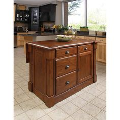 Add additional storage and counter space with this functional kitchen island. The wood island, featuring a rustic cherry finish, will complement the decor of almost every kitchen. The breakfast bar easily extends for your convenience.