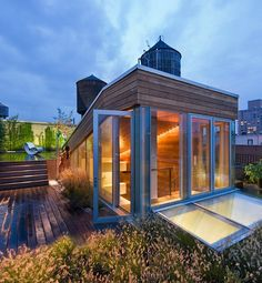 Extreme Rooftop Retreats  The rooftop to a Manhattan NoHo loft (designed by architect Joel Sanders) provides an outdoor living space that includes a shower, movie screen and kitchen.