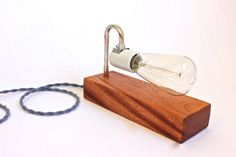 vintage inspired modern lighting from ninoshea. Put it on your desk or hang it on your wall, this versatile lamp is modern, bold and industrial chic. Handmade from beautiful quarter sawn sapele wood, chrome tubing, porcelain socket, cloth cord and an exposed antique style edison light bulb.  www.ninoshea.com