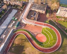 Designed by NEXT Architects, a new bicycle bridge in Utrecht is not only pulling double duty as a pedestrian and bike path, but also forms a roof garden over a local school, all surrounded by a green public park. Plans Architecture, Landscape Architecture Design, Rendering Architecture, Landscape Architects, Architecture Portfolio, Classical Architecture, Ancient Architecture, Path Design, Bridge Design