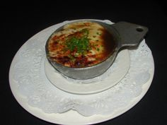 Baked French Onion Soup with Provolone   & Parmesan Crouton $6.95  #TheVeranda #DowntownFortMyers #SouthwestFlorida #FortMyers #finedining #southerncuisine #food #appetizers #frenchonionsoup #bakedfrenchonionsoup