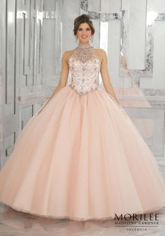 Beautiful Pink Quinceañera Princess Ball gown featuring a Fully Beaded Bodice with High Neckline and a Keyhole Corset Back. Skirt Accented with Delicate Beading. Matching Stole Included. Colors available: Pink Panther, Peacock White, Blush. Sweet 15 Dress by Valencia | Morilee by Madeline Gardner. Style 60011.
