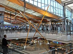 """Triplet"" -- art created in glass, wood, metal and LED by Ed Carpenter, at Raleigh Durham International Airport #RDU"