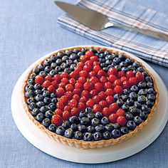 All-Star Berry Tart recipe .... hmmmm another idea if pressed for time is to buy a cheesecake and decorate the top with blueberries and raspberries in this pattern! Love it.