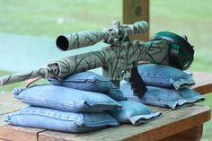 Use old denim pant legs filled with sand as rifle rests for target shooting.