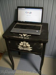 Repurposed sewing machine table into side table or laptop computer table. There is storage for the laptop!