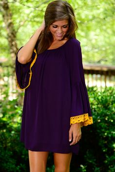 This is seriously THE MOST romantic gameday dress we've ever seen! The simple shift style is accentuated expertly by the bold, lace-trimmed sleeves! With a dreamy neckline and cool,  comfy fit, this one is perfect for a day of food, fun, friends and football! <br /> <br />Bra-friendly! Material has no amount of stretch. This one is sheer, so you'll need a slip or layering tank underneath! :) <br />Miranda is wearing the size small. <br /> <br />Sizes fit: <br />Small - 0-4; Medium- 6-8…