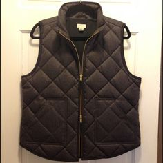 JCrew quilted vest Purchased online and it's a little to big on me.  Wore this once.  In excellent condition.  Charcoal gray color is best shown in last picture. J. Crew Jackets & Coats Vests