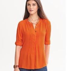 NWT PRETTY BANANA REPUBLIC TOP 100% polyester, machine wash. Banded collar. Covered button placket. Pintuck front. Long sleeves w/ banded button cuffs. It sits at the low hip. Great color great top. ‼️Final Price‼️❌NO PP NO TRADES❌. Color: orangish red Banana Republic Tops
