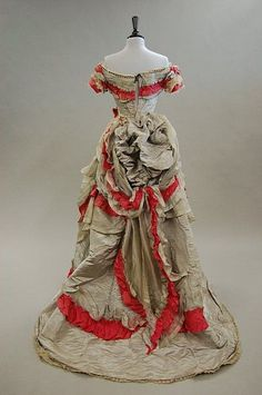 A grey moire taffeta ball gown trimmed with pink silk, circa 1870