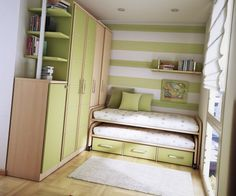 stripes, green, white, shelving, drawers, rug, wood floor, tight space, green pillows, bed, sunlight, window, Photo courtesy of http://firmones.com/