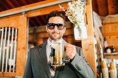 Groomsman enjoying a brew at a rustic barn wedding at The Mason Jar in Onalaska, Wa.  photo by: TGTB COLLECTIVE  Tacoma wedding photographers