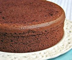 Chocolate chiffon cake is a light and spongy cake. Goes well with a heavy chocolate ganaché coating. Line bottom only of cake pan with parchment paper cut to fit. Chocolate Chiffon Cake, Chocolate Sponge Cake, Chocolate Desserts, Food Cakes, Cupcake Cakes, Sponge Cake Recipes, Vegetarian Chocolate, Cake Plates, Clean Eating Sweets