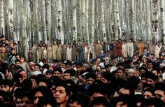 Crowds mourn the death of a family of five following a grenade attack in a village near Srinagar in Badgam, Kashmir. This image was part of the Ami Vitale's story that won the 2nd prize for People in the News stories of 2004.