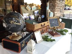 Vintage Travel-Themed Guest Sign-in table with vintage suitcases, atlases, camer. - Vintage Travel-Themed Guest Sign-in table with vintage suitcases, atlases, cameras and rolled maps. Vintage Suitcase Wedding, Vintage Suitcases, Vintage Bridal, Wedding Reception Ideas, Wedding Favors, Wedding Cake, Wedding Invitations, Vintage Table Decorations, Wedding Decorations