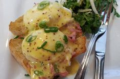 Eggs Benedict With Whole Grain Mustard Hollandaise   It's simply divine spooned over perfectly poached eggs perched atop ham and lightly toasted bread. Serve this dish along with a simple green salad for any meal of the day.