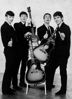 The Beatles give a thumbs up