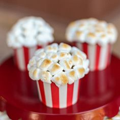Cupcakes that look like miniature tubs of popcorn are delicious and easy to make with their marshmallow topping.