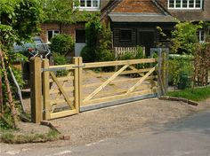 Google Image Result for http://www.tonbridgefencing.co.uk/images/wooden_gates/sliding_timber_field_gate.jpg