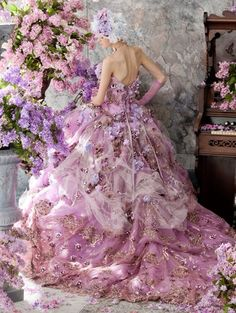 Stella De Libero: breathtaking and beautiful, rich fusions of pinks and purples and lavenders, chiffon and gold embellishments...beautiful flora both as embellishments and patterned in some of the fabric...an exquisite design...