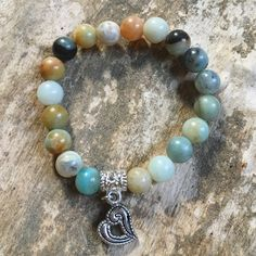 A personal favorite from my Etsy shop https://www.etsy.com/ca/listing/480771211/amazonite-and-heart-charm-bracelet